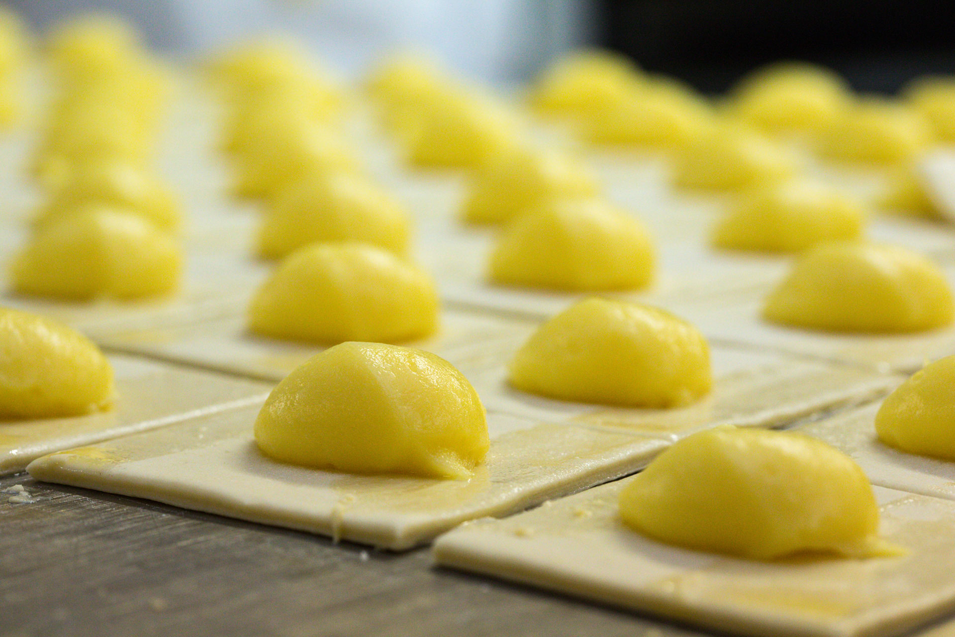Custard Pastries being prepared for baking